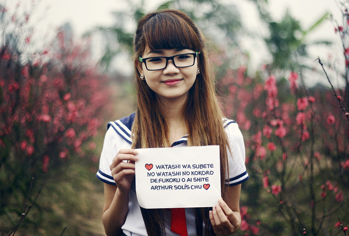 dress up a COSPLAY at cherry blossom field and take nice pictures holding a handwritten sign of your website or business