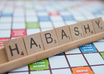 take a professional photo of a name or phrase spelled in Scrabble tiles