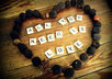 write anything you want in scrabble letters and decorate it with tree seeds Rustic Style on a wooden floor and send you the picture