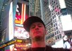 take a pic in the middle of Times Square NYC holding a personalized card or sign